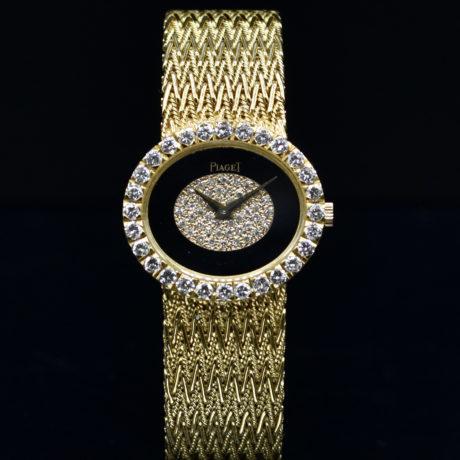 PIAGET LADY'S YELLOW GOLD ONYX AND DIAMONDS